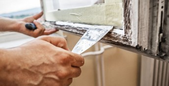 Repairing a window frame -Man using scraper and putty for renovation old windows, Image: 200832423, License: Royalty-free, Restrictions: , Model Release: no, Credit line: Profimedia, Stock Budget