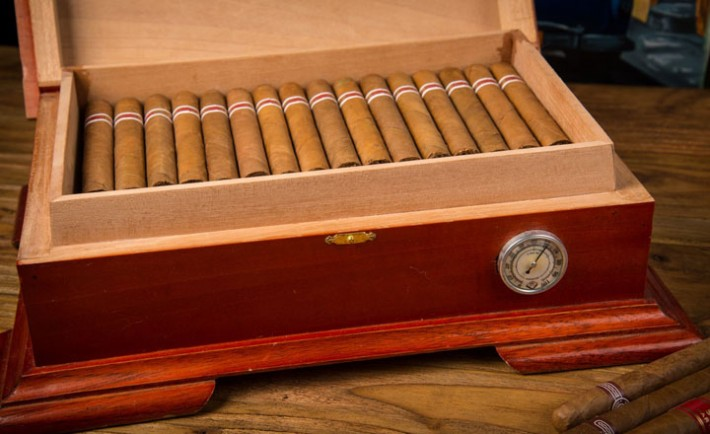 Cuban cigars and humidor on rustic wooden table, Image: 206512839, License: Royalty-free, Restrictions: , Model Release: no, Credit line: Profimedia, Stock Budget