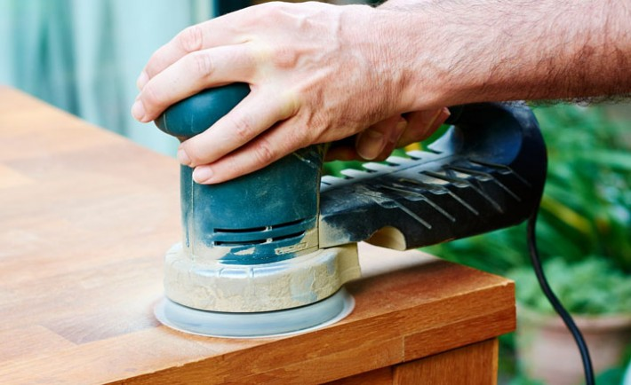 Man sanding an oak table with a random orbital sander, close-up, Image: 259758498, License: Royalty-free, Restrictions: , Model Release: yes, Credit line: Profimedia, Westend61